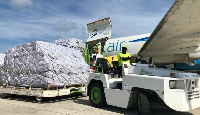 30,000 PPE kits arrive in Cayman from China